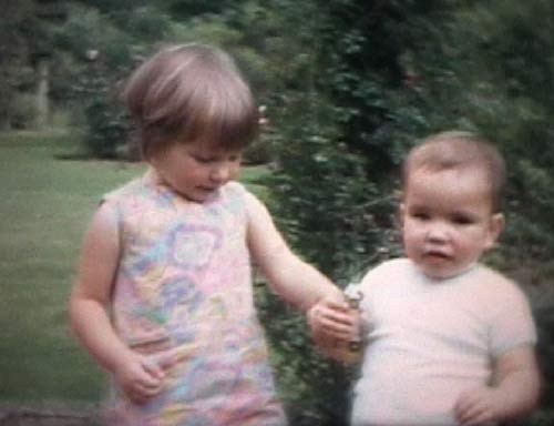 Alison aged 3 and David aged 18 months or so, playing in the garden of our grandparents' house in Winchester