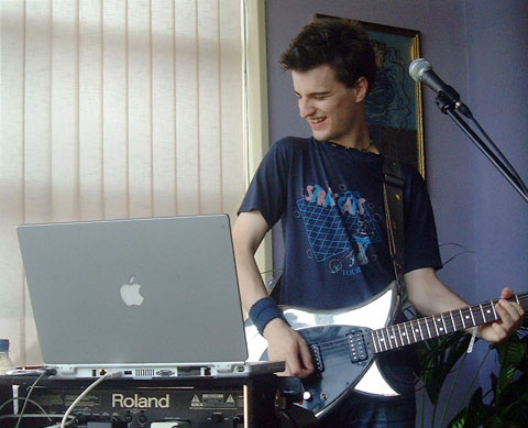 Jim Moray playing electric guitar and PowerBook